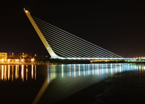 "image credit: Andrew Dunn and Wikipedia Commons; <a href=""http://en.wikipedia.org/wiki/Santiago_Calatrava"" target=_blank"">image source<a/>; <a href=""http://upload.wikimedia.org/wikipedia/commons/b/b2/Calatrava_Puente_del_Alamillo_Seville.jpg"" target=""_blank"">larger image</a>"