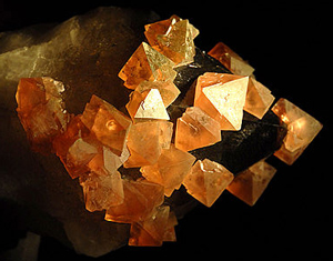 "image credit: Creative Commons; <a href=""http://en.wikipedia.org/wiki/Fluorite"" target=""_blank"">image source</a>; <a href=""http://www.physicstogo.org/images/features/Flourite-large-8-01-08.jpg"" target=""_blank"">larger image</a>"