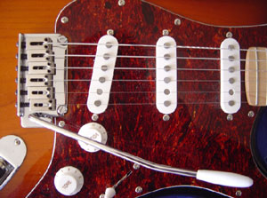 "image credit: ReignMan, Creative Commons; <a href=""http://en.wikipedia.org/wiki/File:Stratocaster_detail_DSC06937.jpg"" target=""_blank"">image source</a>; <a href=""http://www.compadre.org/informal/images/features/Stratocaster--large.jpg"" target=""_blank"">larger image</a>"