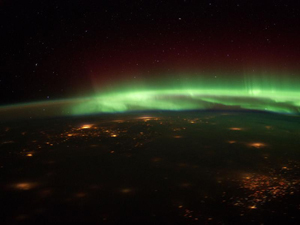 "image credit: NASA; <a href=""http://www.nasa.gov/multimedia/imagegallery/image_feature_2175.html"" target=""_blank"">image source</a>; <a href=""http://www.compadre.org/informal/images/features/Aurora-from-space-NASA-larg.jpg"" target=""_blank"">larger image</a>"