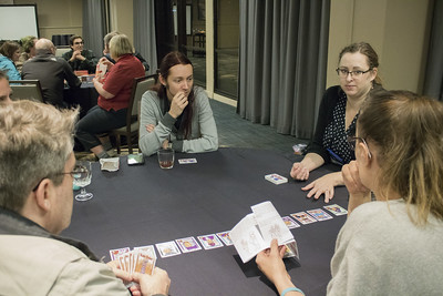 People playing a card game at the 2019 Winter Meeting in Houston