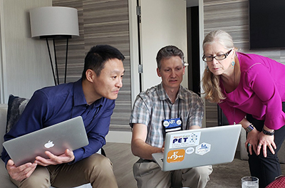 Lin Ding, Steve Maier, and Beth Cunningham working on PERC 20/20, at PERC 2019